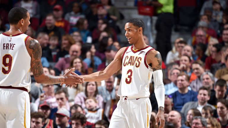 Channing Frye #9 hi-fives Patrick McCaw #3 of the Cleveland Cavaliers during the game against the Utah Jazz on January 4, 2019 at Quicken Loans Arena in Cleveland, Ohio.
