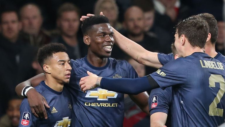 Paul pogba celebrates with Jesse Lingard during the FA Cup win at Arsenal