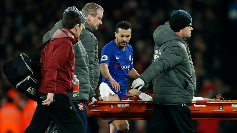 Pedro shows his concern for Hector Bellerin as he's taken off the pitch on a stretcher