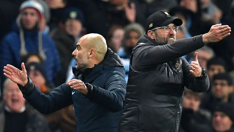 Liverpool boss Jurgen Klopp (right) and his Man City counterpart Pep Guardiola are in a two-way battle for the title