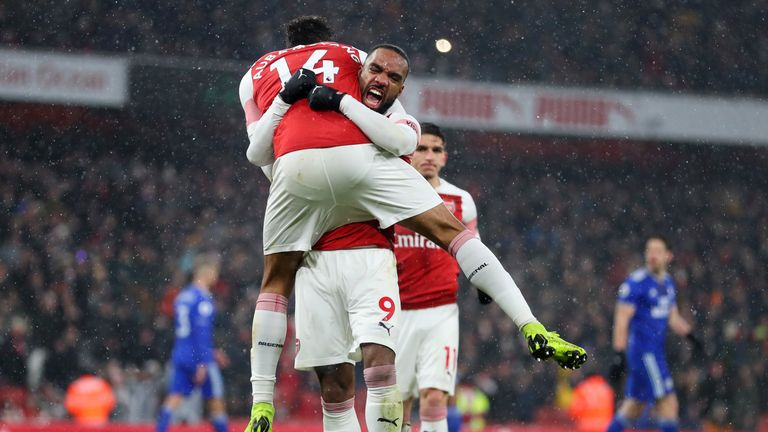 Pierre-Emerick Aubameyang celebrates scoring his penalty with Alexandre Lacazette
