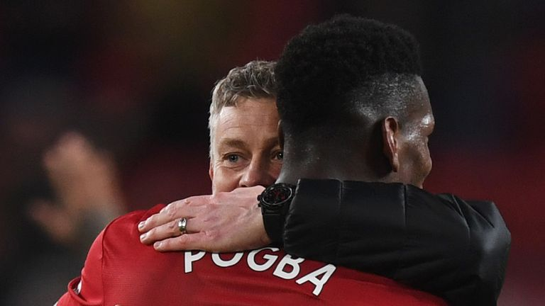 Ole Gunnar Solskjaer, Interim Manager of Manchester United celebrates victory with Paul Pogba after the Premier League match between Manchester United and AFC Bournemouth at Old Trafford on December 30, 2018 in Manchester, United Kingdom.