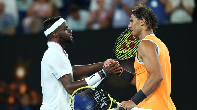 Tiafoe (Left) congratulates Nadal on his victory