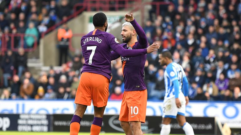 Raheem Sterling celebrates with Sergio Aguero after scoring his side's second goal during the Premier League match between Huddersfield Town and Manchester City at John Smith's Stadium on January 20, 2019 in Huddersfield, United Kingdom.