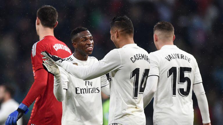 Casemiro celebrates his opening goal with Vinicius Junior