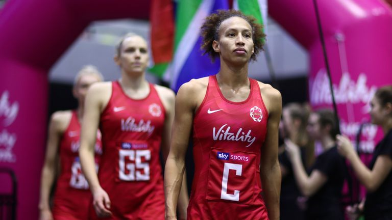 Serena Guthrie walking out onto court for England's Netball Quad Series match against South Africa