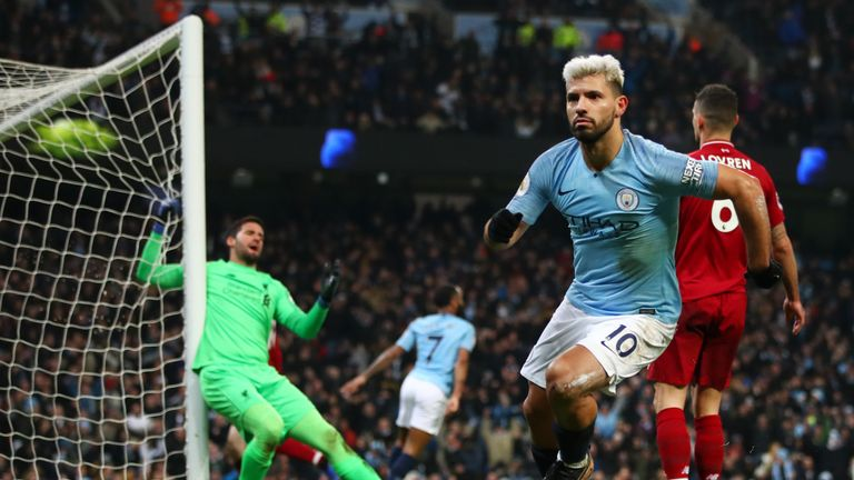 Sergio Aguero runs from goal in celebration after giving Manchester City the lead