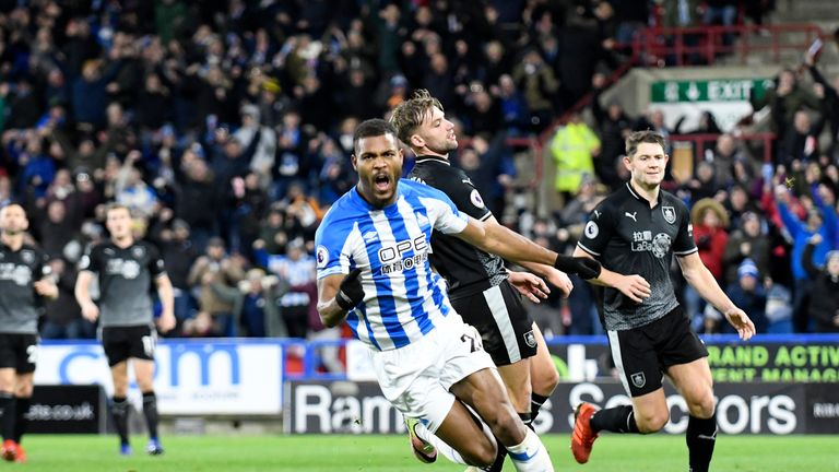 Steve Mounie celebrates after putting Huddersfield ahead