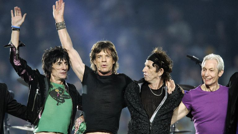 The Rolling Stones salute the Detroit crowd following their Super Bowl set list