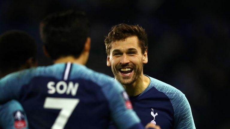 Fernando Llorente celebrates scoring Tottenham's second goal with team-mate Heung-Min Son
