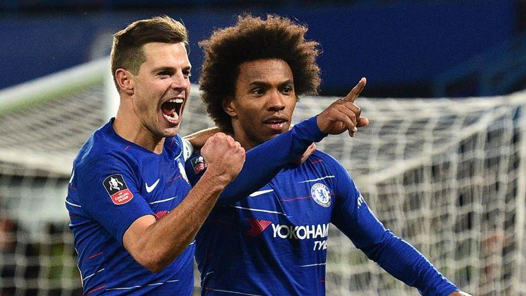 Willian celebrates scoring a penalty with Chelsea defender Cesar Azpilicueta