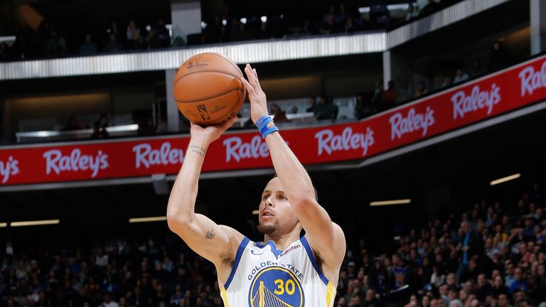 Stephen Curry fires a three-pointer