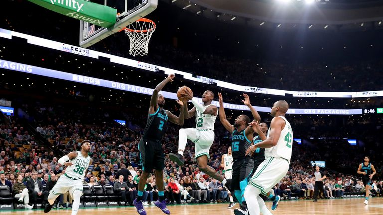 Terry Rozier drives to the hoop against Charlotte