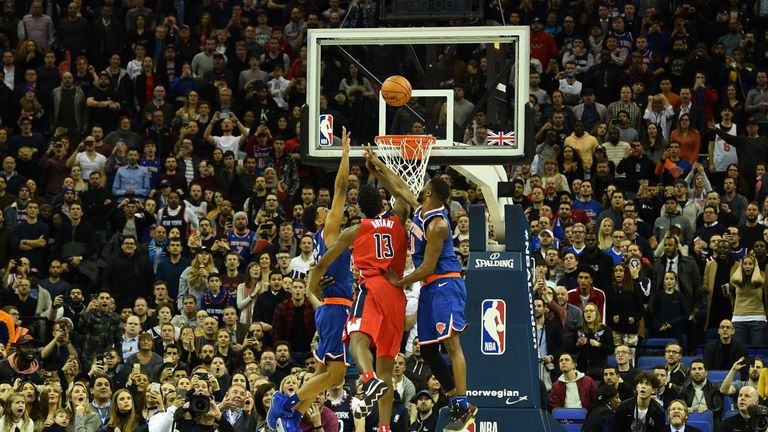 Thomas Bryant's last-second shot is rejected by Allonzo Trier who is then called for goal-tending to seal a 101-100 victory for the Washington Wizards over the New York Knicks