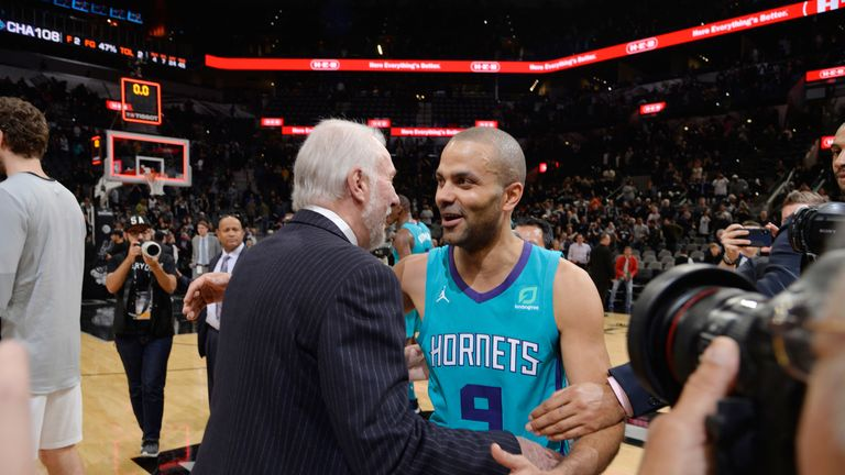 619fabae51c0 Tony Parker embracing Spurs coach Gregg Popovich on his San Antonio return  with Charlotte