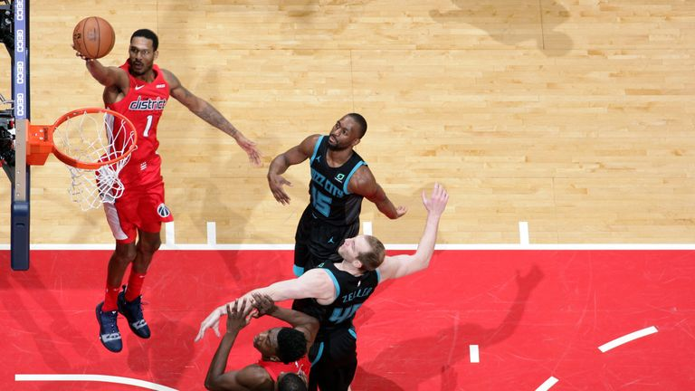 Trevor Ariza scores with a lay-up against Charlotte
