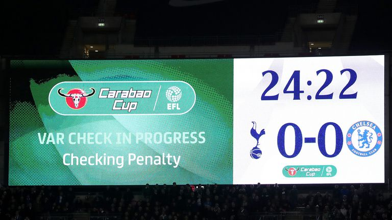 The LED screen displays a message stating that VAR Checking is in process during the Carabao Cup semi-final between Tottenham and Chelsea