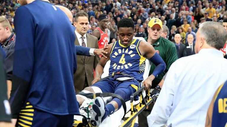 An injured Victor Olapido is stretchered off the court during Indiana's clash with Toronto