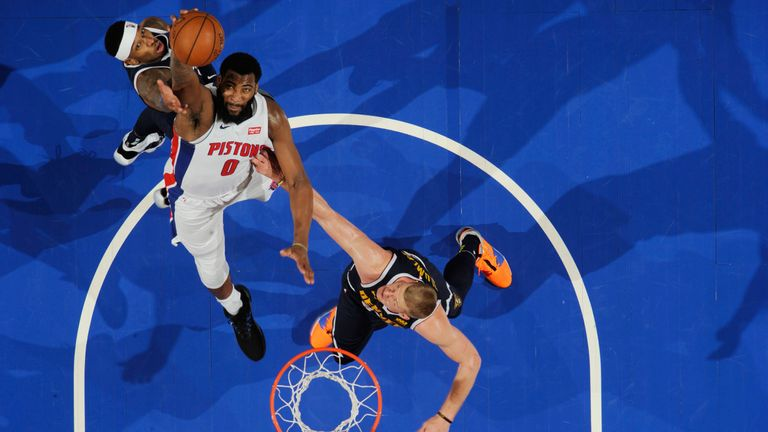 Andre Drummond claims a rebound against Denver