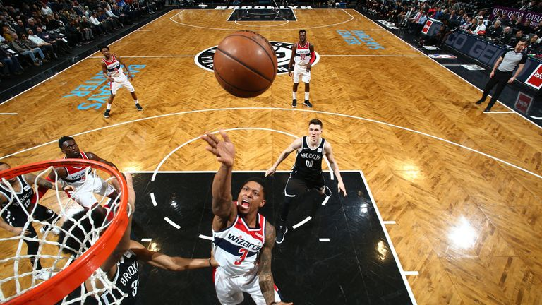 Bradley Beal shoots close to the basket against Brooklyn