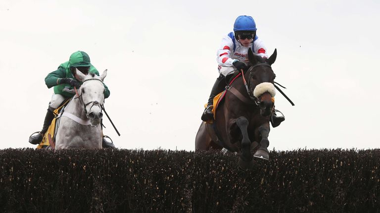Clan Des Obeaux and Harry Cobden (right) lead Terrefort at Ascot