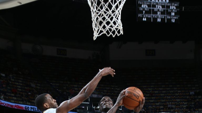 Darren Collison attacks the basket against New Orleans