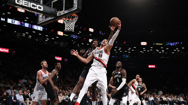 Enes Kanter corrals a rebound on his Portland debut