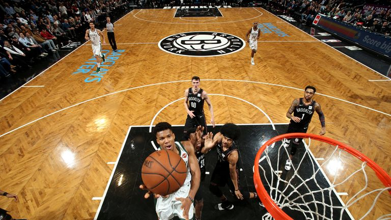 Giannis Antetokounmpo scores with a lay-up against Brooklyn