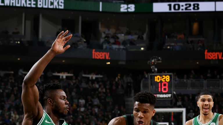 Giannis Antetokounmpo battles the Celtics defense