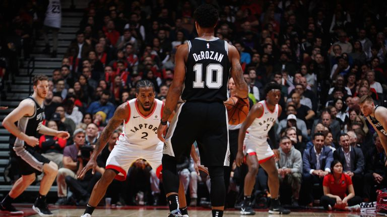 Kawhi Leonard guards DeMar DeRozan