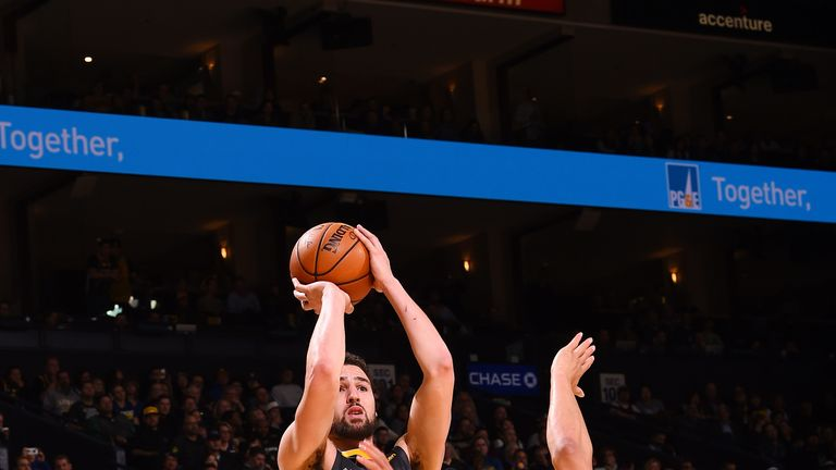 Klay Thompson fires a fadeaway jump shot against San Antonio