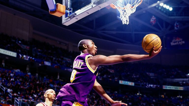 Kobe Bryant lofts a circus shot at All-Star Weekend