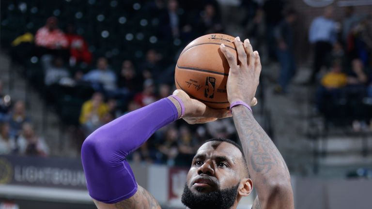 LeBron James lofts a jump shot against the Indiana Pacers