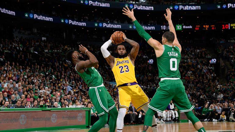 LeBron James passes out of a Celtics double team