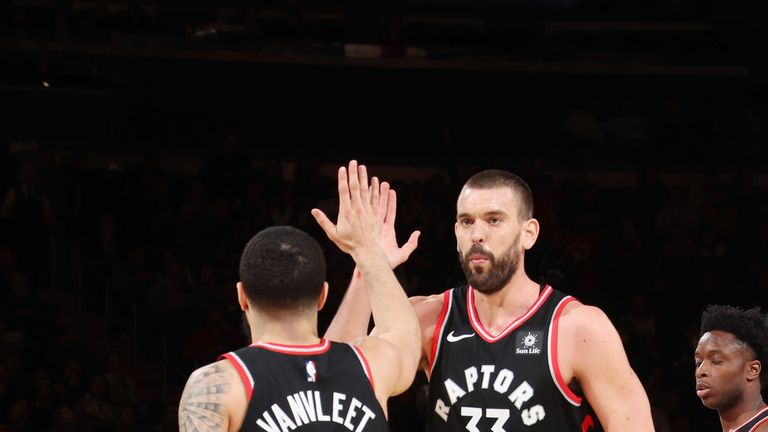 Marc Gasol high-fives Raptors team-mate Fred VanVleet