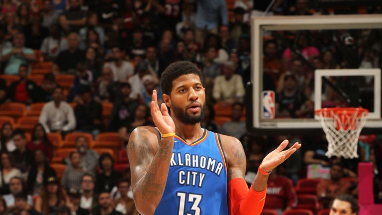 Paul George applauds his team-mates during the Thunder's resounding win in Miami