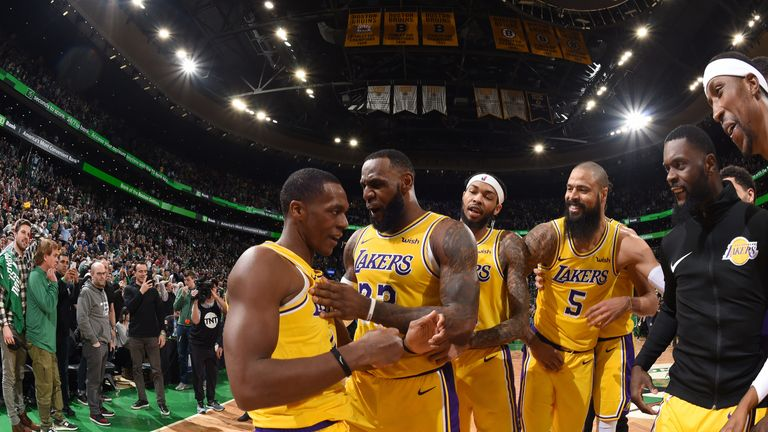 Rajon Rondo is mobbed by his Lakers team-mates after hitting a game-winning shot