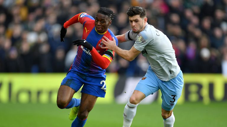 Aaron Wan-Bissaka battles for possession with Aaron Cresswell