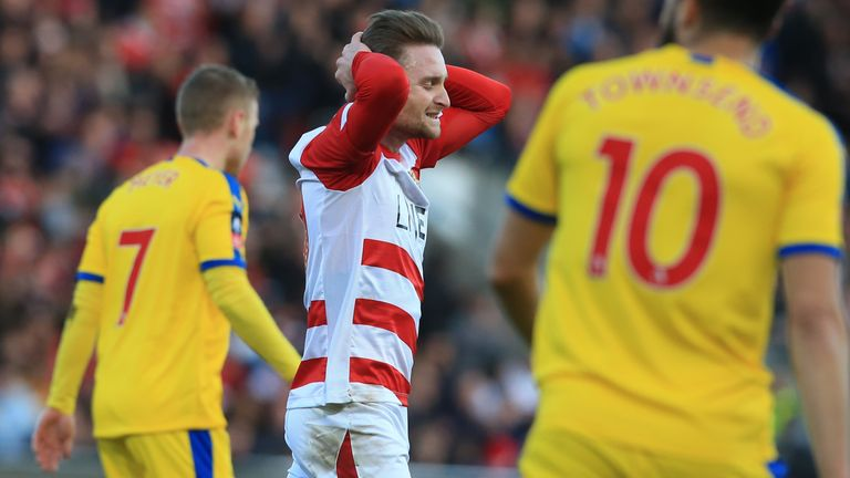 Alfie May spurned Doncaster's best chance when he headed over