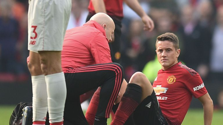 Ander Herrera receives treatment on the pitch after picking up an injury