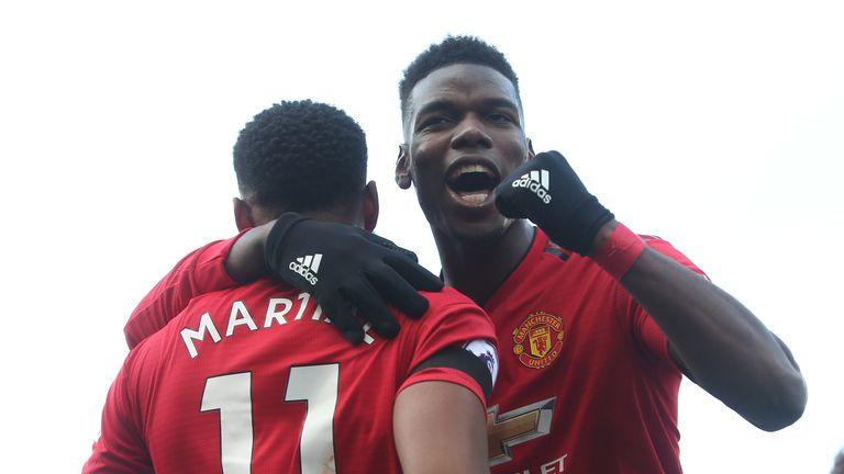 Anthony Martial celebrates with Pogba