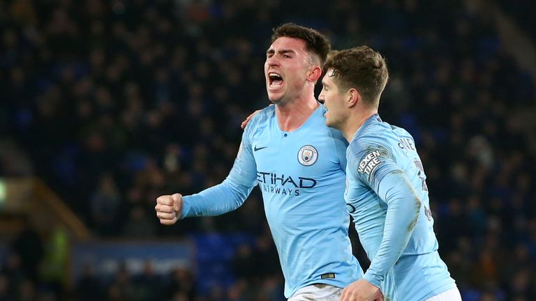 Aymeric Laporte of Manchester City celebrates with John Stones of Manchester City after he scores his sides first goal during the Premier League match between Everton FC and Manchester City at Goodison Park on February 06, 2019 in Liverpool, United Kingdom