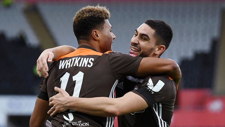 Ollie Watkins celebrates his opener for Brentford against Swansea with team-mate Neal Maupay