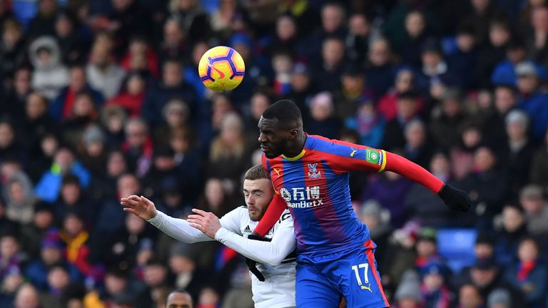 Christian Benteke goes up for a header against Calum Chambers