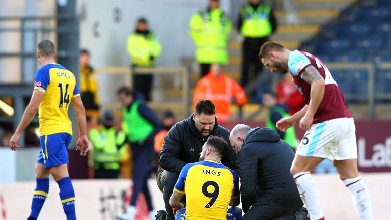 Ings receives treatment in the first half at Turf Moor