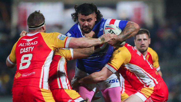 David Fifita is tackled by Catalans' Remi Casty, Sam Moa and Matt Whitley