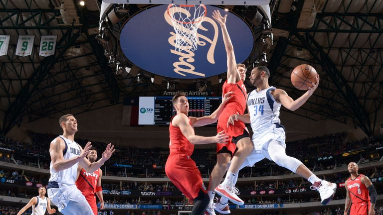 Devin Harris of the Dallas Mavericks looks to passes the ball against the Portland Trail Blazers