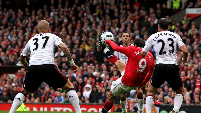 Dimitar Berbatov sends a brilliant overhead kick goalwards as he scored a hat-trick for Manchester United against Liverpool