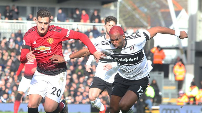 Diogo Dalot in action with Ryan Babel at Craven Cottage