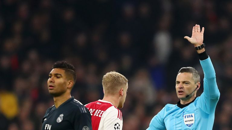 Referee Damir Skomina explains to Donny van de Beek about why Ajax's goal was disallowed